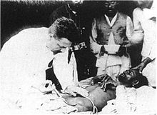 https://upload.media.orgikipedia/commons/thumb/f/ff/Paul-Louis_Simond_injecting_plague_vaccine_June_4th_1898_Karachi.jpg/220px-Paul-Louis_Simond_injecting_plague_vaccine_June_4th_1898_Karachi.jpg